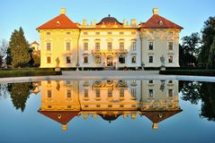 Slavkov castle reflected in water Stock Photography