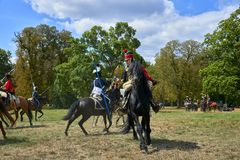 Cavalrymen in historical uniform show the battle stock photography