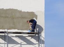 Plasterers Builders plastered wall in a commercial building. Wor Stock Photography