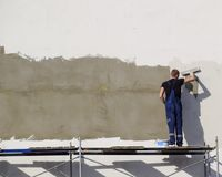 Plasterers Builders plastered wall in a commercial building. Wor Royalty Free Stock Photography