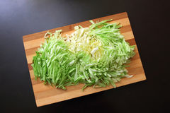 Slaw on a cutting board. And a dark countertop Royalty Free Stock Image