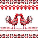 Slawisches aufwändiges mit zwei roten Hahnen Stockfotos