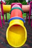 Slayder тоннеля от спортивной площадки детей Стоковое фото RF