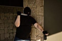 Slayer waiting his victim behind a door Stock Images