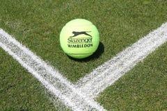 Slazenger Wimbledon Tennis Ball on grass tennis court. NEW YORK - JUNE 26, 2018: Slazenger Wimbledon Tennis Ball on grass tennis court. Slazenger Wimbledon stock photography