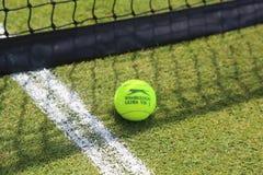 Slazenger Wimbledon Tennis Ball on grass tennis court Royalty Free Stock Photo