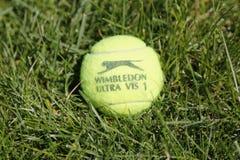 Slazenger Wimbledon Tennis Ball on grass tennis court. NEW YORK - JUNE 22 Slazenger Wimbledon Tennis Ball on grass tennis court on June, 22, 2014 in New York royalty free stock images