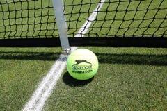 Slazenger Wimbledon Tennis Ball on grass tennis court. NEW YORK - JUNE 26, 2018: Slazenger Wimbledon Tennis Ball on grass tennis court. Slazenger Wimbledon royalty free stock image