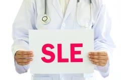 SLE disease. Doctor holding billboard label with SLE disease, medical concept stock image