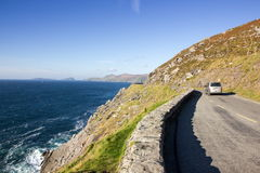 Slea head drive in Dingle. Coast road from Dingle to Dunquin & x28;Slea head drive& x29;with distant view of the Blasket islands Stock Photography