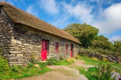 Slea Head Famine Cottages in Ireland royalty free stock photo