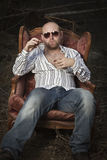 Sleazy Man in a Vintage Chair Royalty Free Stock Images