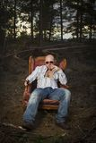 Sleazy Man in a Vintage Chair Royalty Free Stock Photos