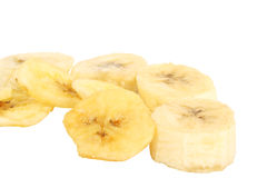Sleced dried bananas. Some sleced dried bananas on white background (isolated, clipping path royalty free stock photography