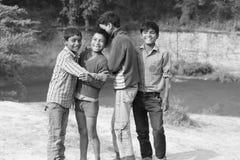 slechte kinderen ` s met rijke glimlach royalty-vrije stock foto