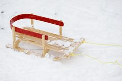 Sled. Red wooden sled in the snow Royalty Free Stock Photo