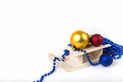 Sled and christmas decoration Stock Photography