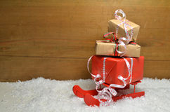 Sled and Gifts in Snow Christmas Royalty Free Stock Images