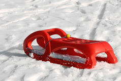 Sled for playing in the snow in mountains Royalty Free Stock Images