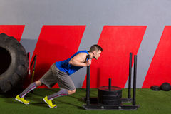 Sled push man pushing weights workout exercise Stock Photo