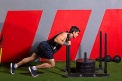 Sled push man pushing weights workout exercise stock images