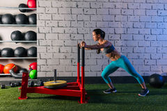 Sled push woman pushing weights workout. Exercise Royalty Free Stock Photography
