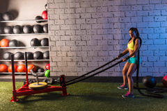 Sled rope pull woman pulling weights workout Stock Photo