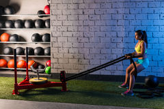 Sled rope pull woman pulling weights workout Royalty Free Stock Photo