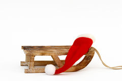 Sled and santa hat Stock Image