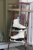 Sled and skates: Winter fun. Skates hanging from an old fashioned sled on the porch Royalty Free Stock Photography