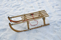 Sled in the snow. A traditional bavarian wooden sled in the snow stock image