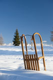Sled on the snow. Mountain background Royalty Free Stock Photo