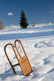 Sled on the snow. Mountain background Stock Photo
