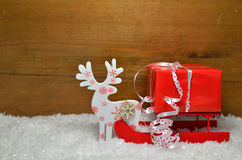 Sled Snow Christmas wooden background Royalty Free Stock Photos