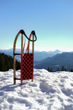 Sled in snow. A sled in snow in a German mountain landscape Royalty Free Stock Photo