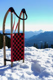 Sled in snow at mountains Royalty Free Stock Image