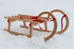 Sled. Wooden sled in the snow in winter Stock Photo