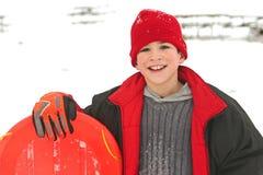 sledding的男孩 免版税库存图片