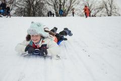 Sledding в парке Стоковая Фотография