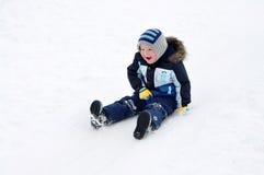 Sledding. Boy is sledding down a snow hill Royalty Free Stock Photo