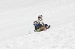 雪sledding崩溃 免版税库存照片