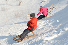 Sledding. Children sledding Stock Photos