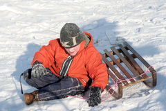 Sledding. A boy falling Stock Image