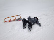 Sledding Accident (2). Girl fell from her sled while tobogganing at Imberger Horn in the German Alps Royalty Free Stock Photo