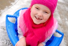 Sledding Angel. 6 year old redheaded girl sledding Royalty Free Stock Photo