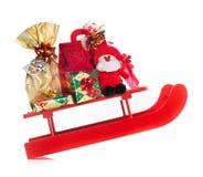 Sledding with Christmas gifts prancing Stock Image