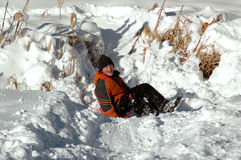 Sledding down a snowy hill Stock Image