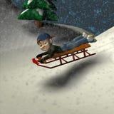 Sledding Fun. Small boy enjoying a day of sledding in the snow Royalty Free Stock Image