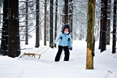 Sledding girl Stock Image