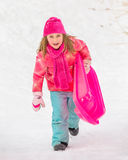Sledding Girl - Climbing Up Hill Stock Photos